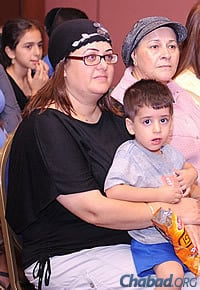 A mother and her young son at the Sunday event