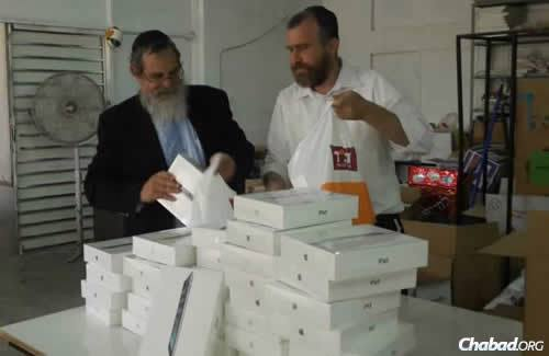Eliezrie, left, with Rabbi Yossi Swerdlov of the Chabad Terror Victims Project