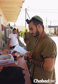 Putting on tefillin has been a spiritual boon for soldiers.