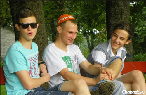 Teens taking a break. For some, Lugansk cannot fade into the background because family members remain there, unable to leave.