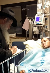 Rabbi Kotlarsky writes down a soldier's request for blessings to be read at the Ohel, the Rebbe's resting place in Queens, N.Y.