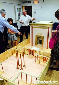 """Chabad Lubavitch of Riverdale, N.Y., offered an activity called """"Build Your Own Beit Hamikdash,"""" where both adults and children helped assemble the 15-by-5-foot model."""