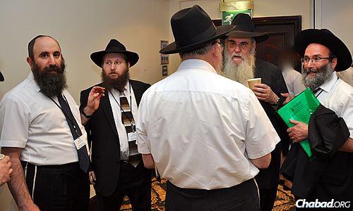 Rabbi Moshe Kotlarsky, center, with, from left, Rabbi Yehuda Pink, Rabbi Levi Wineberg, Rabbi Yitzchok Sufrin (back to camera) and Rabbi Aryeh Sufrin, MBE.