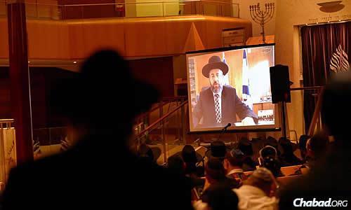 Israel's chief Ashkenazi rabbi, Rabbi David Lau, spoke via Skype from Jerusalem, thanking everyone for their support and sharing teachings from the Torah. (Photo: Ingrid Shakenovsky)
