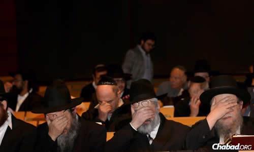 Rabbinic leaders join in reciting the Shema Yisrael prayer. (Photo: Ingrid Shakenovsky)