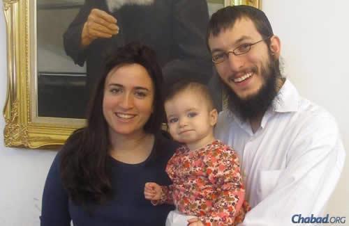 Rabbi Yisroel and Chaya Kozlovsky, with their daughter Nava.