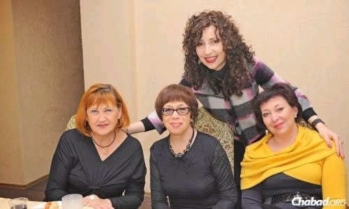 Chana Gopin (standing), the writer of this article, with friends at a Chanukah activity in Lugansk.