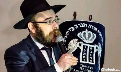 An original gift: Rabbi Shalom Gopin with a Torah scroll dedicated on his birthday.