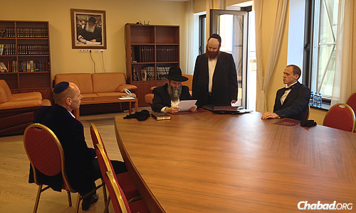Rabbi Shmuel Kaminezki, chief rabbi of Dnepropetrovsk, prepares a ketubah together with the groom, seat at right, for a Jewish wedding taking place at Menorah Center.