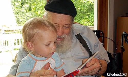 In 2000, the rabbi retired after 35 years of service. Here, he enjoys time with one of his many grandchildren.