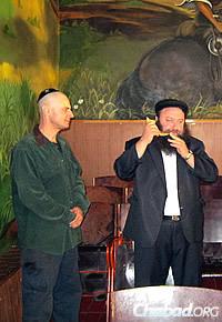 Raices blows shofar for Jewish inmates at High Holiday time.