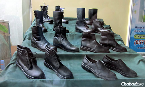 Colony No. 18 produces heavy boots and shoes; samples are prominently displayed in a glass case inside the building. (Photo: Dovid Margolin)