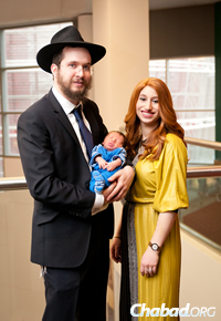 Rabbi Henoch and Sarah Rosenfeld, and their son Mendel, now in Pittsburgh, Pa.