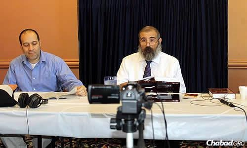 The live class was the brainchild of tech investor and regular class attendee Daniel Aharonoff, left, who says it took more than a year of secretly taping the classes given at the Chabad House before the rabbi agreed to open the course to the public.