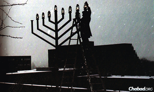 In the mid-1980s, Rabbi Yosef Landa of Chabad of Greater St. Louis kindles the menorah on the seventh night of Chanukah in the St. Louis county plaza.