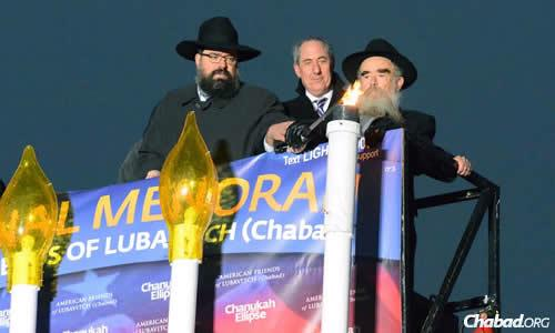 In December 2013—39 years after lighting the first public menorah stood alone in front of Indpendence Hall in Philadelphia—Rabbi Abraham Shemtov, right, along with Rabbi Levi Shemtov, executive vice president of the American Friends of Lubavitch (Chabad) and U.S. Trade Representative Michael Froman, lit the National Chanukah Menorah on the Ellipse, just south of the White House, before thousands of visitors and dignitaries. (Photo: Judah Lifshitz)