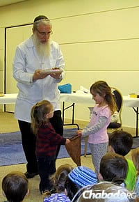 The rabbi visits all kinds of groups and schools in the Denver area, talking about Chanukah and the miracle of the oil.
