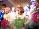 Menorahs and acrobats share stage in Asheville fest