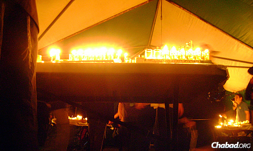 Due to the risk of bushfires in the Outback during the dry summer season, extra care has to be put into the placement of menorahs, especially near camp tents. There's even a person responsible for watching them at all times.