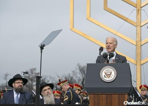 U.S. Vice President Joe Biden addresses the crowd at the National Menorah lighting, as Rabbi Levi Shemtov, left, and Rabbi Abraham Shemtov look on. (Photo: Ron Sachs)