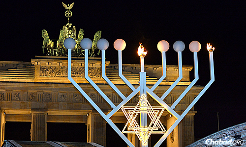 The first night's candle shines boldly and brightly over a site once marked by Nazi hatred. (Photo: David Osipov)