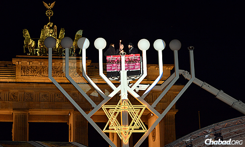 Chabad-Lubavitch of Berlin's director Rabbi Yehuda Teichtal oversaw the lighting of a 30-foot menorah—the tallest in Europe—at the Brandenburg Gate in Berlin on Tuesday night, the first night of Chanukah. (Photo: David Osipov)