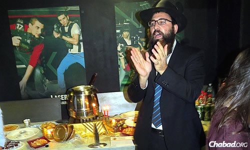 The rabbi leads activities at a recent Chanukah event held on the second night of the holiday.
