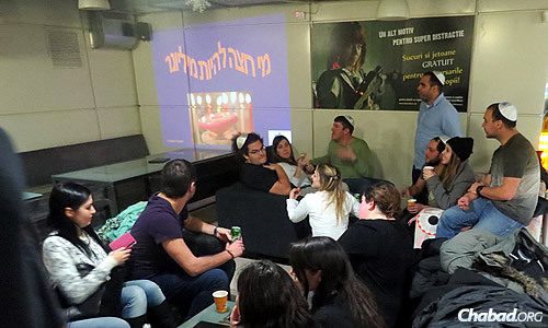 Students unwind, converse and enjoy refreshments during Chanukah.