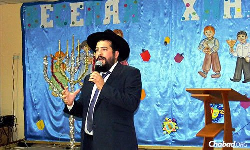 Rabbi Mendel Cohen, rabbi of Mariupol, Ukraine, and co-director of Chabad there with his wife, Ester, did not hold an outdoor public menorah-lighting this year, but did host numerous holiday events for all age groups.