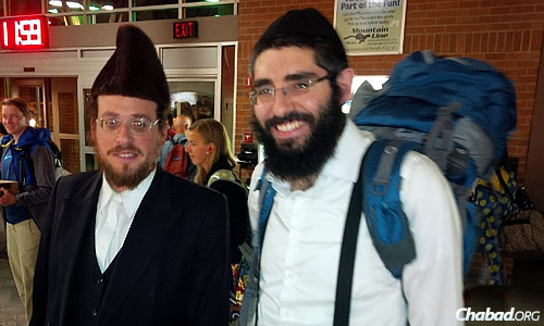 Rabbi Berry Nash, right, co-director of Chabad Lubavitch of Missoula, Mont., met mohel Moshe Roth at the airport in August when he arrived from New York to perform the brit milah for the Nashes' newborn son. Nash's father also flew in with a Torah lent out by the Beis Yisroel Torah Gemach in Brooklyn, N.Y., contained in the blue backpack.
