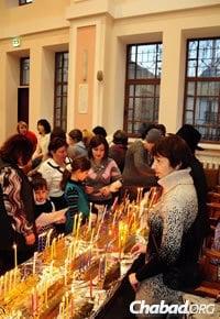 Lighting Chanukah candles at the Shabbaton