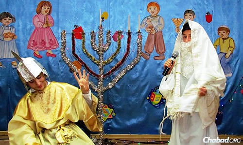 """The children's part of a Chanukah concert in Mariupol. Rabbi Cohen says """"Chanukah was really amazing. People were so happy to see us; that we were there, celebrating together."""""""