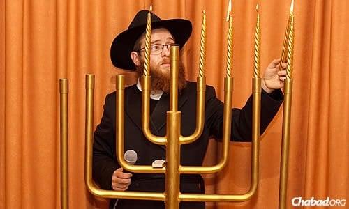 Rabbi Aryeh Schvartz lights the menorah during a Chanukah celebration at the Jewish community center in Donetsk.