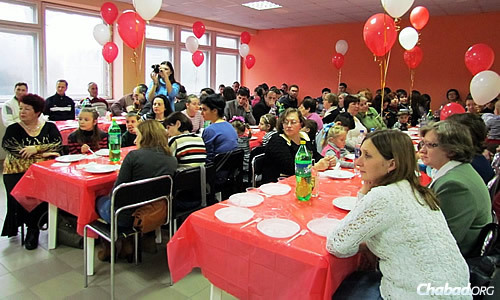 A Chanukah meal for families in Mariupol; its Jewish community, including a kindergarten and daily minyan at synagogue, continue to function despite the war.