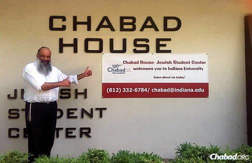 """Rabbi Yehoshua Chincholker, co-director of the Indiana University Chabad House-Jewish Student Center in Bloomington, Ind., in front of the campus Chabad center; he and his wife, Zlata, are sponsoring a """"Paris Shabbat"""" for students this week in solidarity with the Jews of France."""
