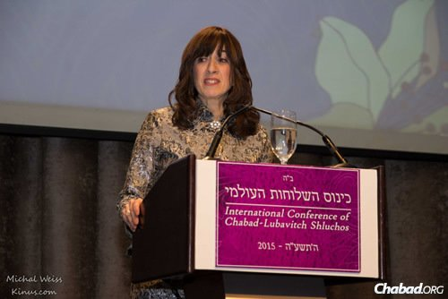 """Goldie Avtzon, co-director of Chabad of Hong Kong with her husband, Rabbi Mordechai Avtzon, gave the keynote address on this year's theme, """"Indeed, I am going with you,"""" which highlights the Rebbe's connection with the emissaries. (Photo: Michal Weiss/Kinus.com)"""