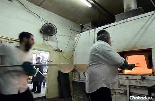 Putting the dough into the ovens to bake