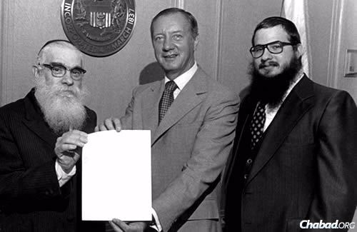 Rabbi Solomon S. Hecht's popular radio presence was one of the many ways in which he impacted the Chicago Jewish community. Here, he is pictured with Michael Anthony Bilandic, the 49th mayor of Chicago, and the late Rabbi Daniel Moscowitz, who founded his own Friday radio program after Hecht's passing in 1979.