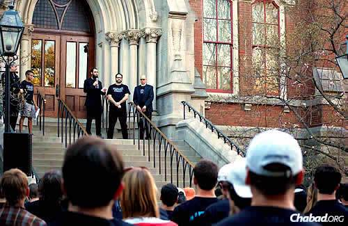 Rabbi Shlomo Rothstein, co-director at the Rohr Chabad House at Vanderbilt University in Nashville, Tenn., speaks on the steps of Kirkland Hall, the school's administration offices, after a March 30 rally in response to vandalism at a Jewish fraternity house. Next to him is Hillel campus director Ari Dubin, and at right, associate provost and dean of students Mark Bandas. AEPi president Josh Hyman and director of the Nashville Jewish Federation Mark Freedman also spoke.