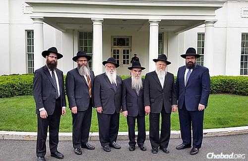 The delegation included, from left, Rabbi Meir Moscowitz; Rabbi Yossy Gordon; Rabbi Yisroel Shmotkin; Rabbi Abraham Shemtov; Rabbi Moshe Herson; and Rabbi Levi Shemtov.