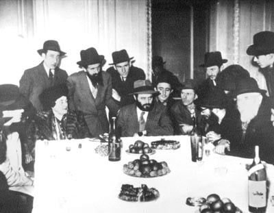 Paris, 1947. After the reunion of Rebbetzin Chana with her oldest son, a special reception was prepared with the participation of chassidim and friends. Here the future Rebbe farbrenged, his mother sitting to his right.