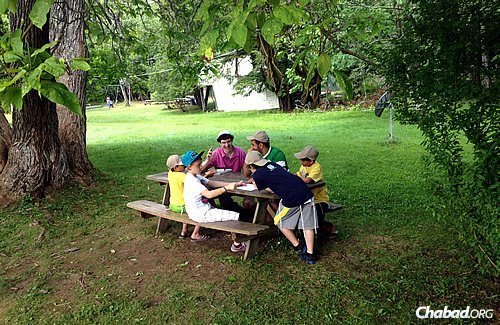 Enjoying some down time at a picnic bench on the grounds.