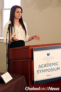 """Samantha Lynne Friedman, a student at Texas A&M University in College Station, Texas, presents her paper titled """"The Jewish Identity Crisis: Where Do You Stand in Your Jewishness?"""" (Photo: Bentzi Sasson)"""