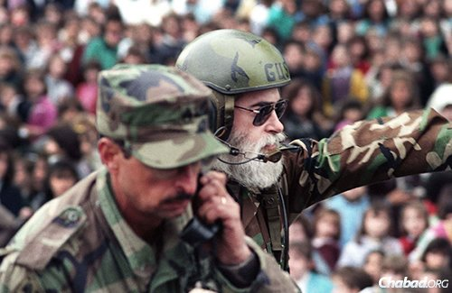 Goldstein enlisted in the U.S. Army as a chaplain 38 years ago, serving with distinction as the highest-ranking Jewish chaplain for decades. Here, he drives by at the Lag BaOmer parade on May 13, 1990 (5750) in the Crown Heights neighborhood of Brooklyn, N.Y. (JEM Photo)