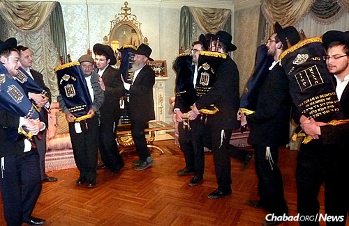 Dancing with the Torahs, some of which will stay in the United States; others will be sent to Paris, Argentina and Canada.