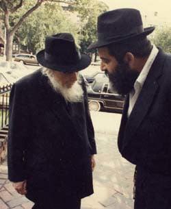 Rabbi Chaim Mordechai Aizik Hodakov, left.