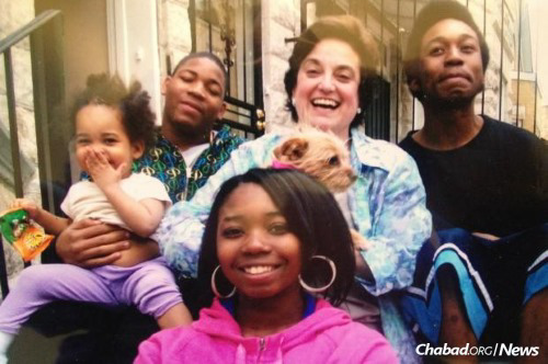 Goldberg surrounded by members of the Smith family: from left, Sha'La, Jeremiah, Angel and Darius.