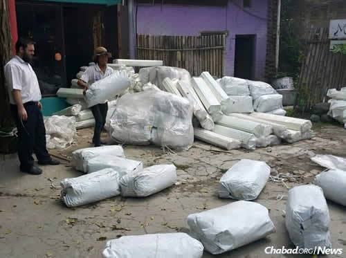 Lifshitz supervises new tents being readied for shipping to areas alll over. (Photo: Chabad of Nepal)