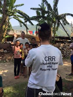 Volunteers bring supplies and cheer to Nepali kids. (Photo: Chabad of Nepal)