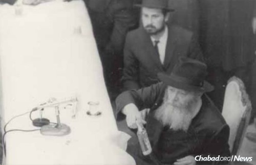 At an early farbrengen with the Rebbe.